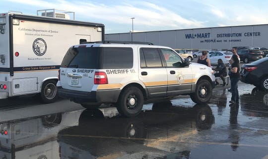 A Department of Justice Crime Scene Response Unit arrives outside the Red Bluff Walmart Distribution Center where at least two people were killed, including a shooting suspect and an employee, and four were injured, on Saturday, June 27, 2020.