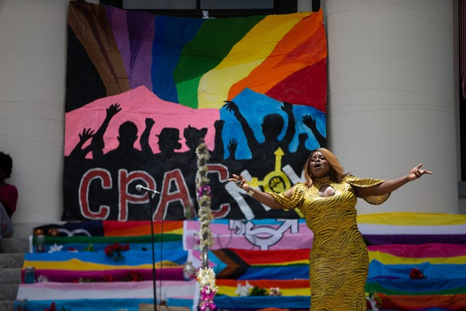 Drag queen Sassy Black performs a song from the steps of the Florida Historic Capitol during a Black Lives Matter and Stonewall Riots anniversary march and event Sunday, June 28, 2020.