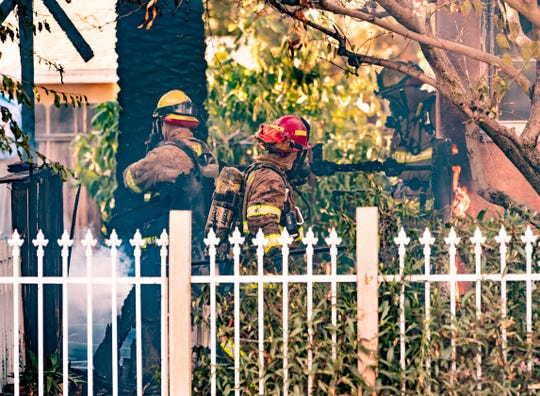 Visalia Fire Department responds to a structure fire in the 1000 block of North Highland Street on Saturday, June 27, 2020. Three fire engines, two firetrucks, a battalion chief and an ambulance were dispatched just after 6 p.m. A neighbor saw the fire and notified the two people at home in time for them to evacuate safely. No injuries were reported. The fire started at the rear of the home and spread inside to the kitchen and the attic. The cause is under investigation.