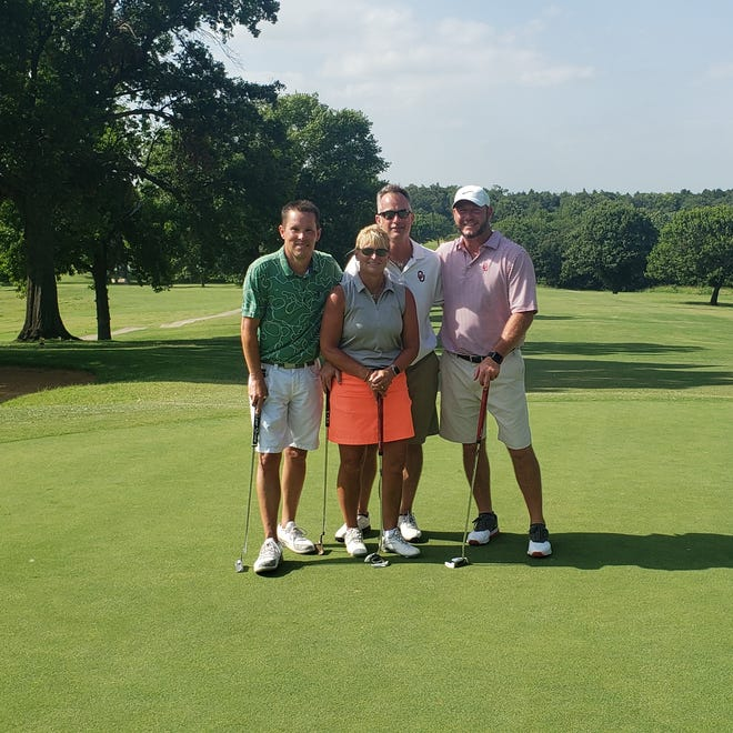Dr. Jeni Merrick-Baker and her team from Ears of Ardmore participate in the annual MORE Foundation Golf Tournament Monday. Dr. Merrick-Baker is the board chairmen of the More Foundation. Her father and grandfather founded the organization 30 years ago.