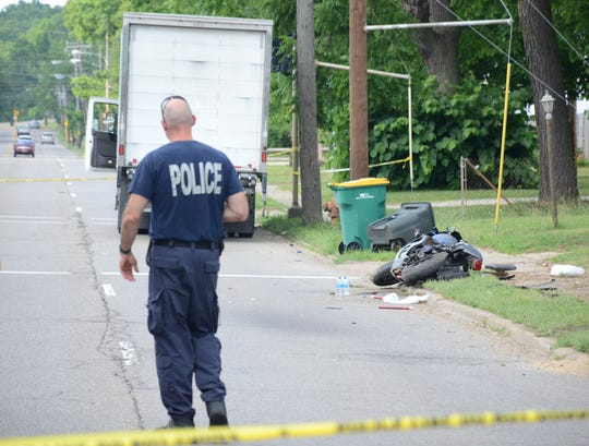 A 24-year-old man was killed when his motorcycle struck the rear of a truck on Bedford Road Monday.  Trace Christenson/The Enquirer