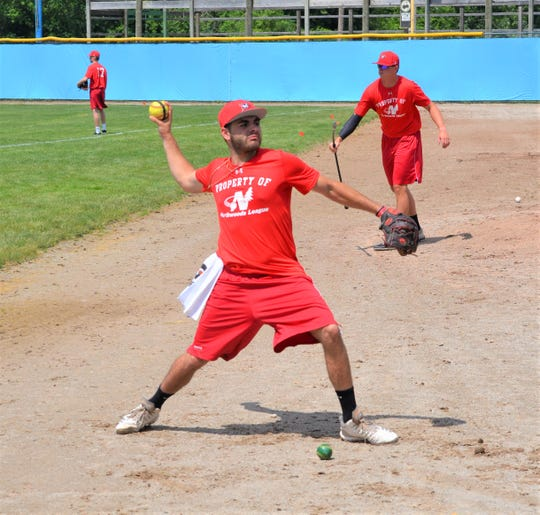 Pablo Arevalo, going through team warmups at C.O. Brown Stadium on Saturday, returns for his third summer with the Battle Creek Bombers.