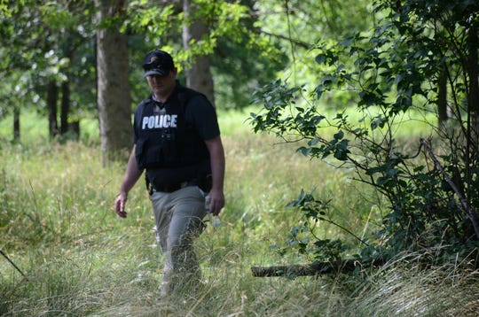 Battle Creek detectives search property on Monday on Waubascon Road looking for the body of Amber Griffin.