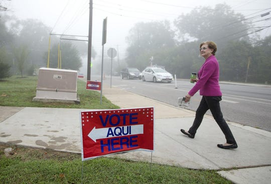 "Travis County Clerk Dana DeBeauvoir walks to a voting location at Zilker Elementary School on Election Day in 2015. While turnout for runoff elections generally runs in single digits, DeBeauvoir said for July 14 one ""might just get as high as 30%"""