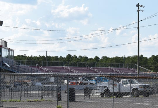 Bleachers rise above a quarter-mile racing strip at Atco Dragway in Waterford Township.