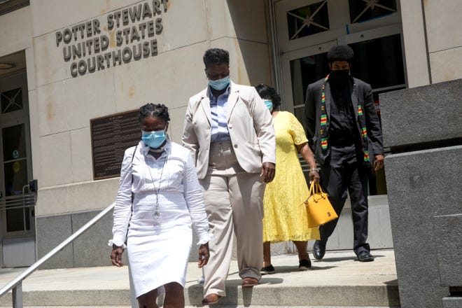 From left, Iris Roley, Tamaya Dennard, Margaret Dennard, Tamaya's mother, and The Rev. Nelson Pierce leave the federal courthouse in Cincinnati on Monday, June 29, 2020. Tamaya Dennard pleaded guilt to a federal fraud charge.