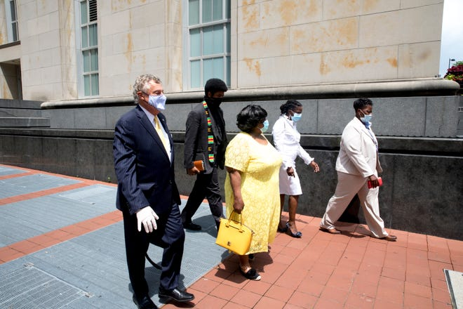 From right, Tamaya Dennard, Iris Roley, Cincinnati activist, Margaret Dennard, Tamaya's mother, The Rev. Nelson Pierce and Marty Pinales, Tamaya's lawyer, leave the federal courthouse in Cincinnati on Monday, June 29, 2020. Tamaya Dennard pleaded guilt to a federal fraud charge.