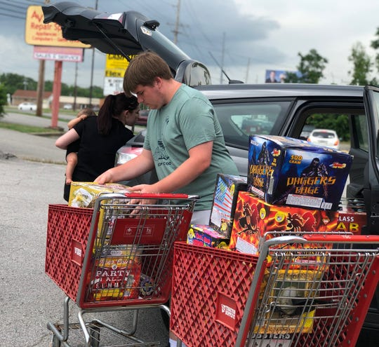Gabriella Roberts, 20, left, and Cullin Roberts, 18, load up their car with $1,500 in fireworks from Southern Boom on Fort Campbell Boulevard on June 29, 2020, to prepare for their Fourth of July celebration.