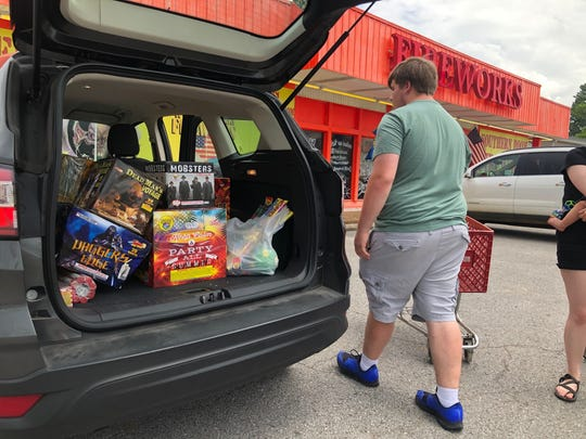 Cullin Roberts, 18, loads up the car with $1,500 in fireworks from Southern Boom on Fort Campbell Boulevard to prepare for a Fourth of July celebration.