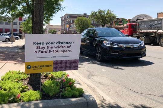 A sign advising citizen to stay 6 feet apart is seen in Dearborn on Monday, June 29, 2020.