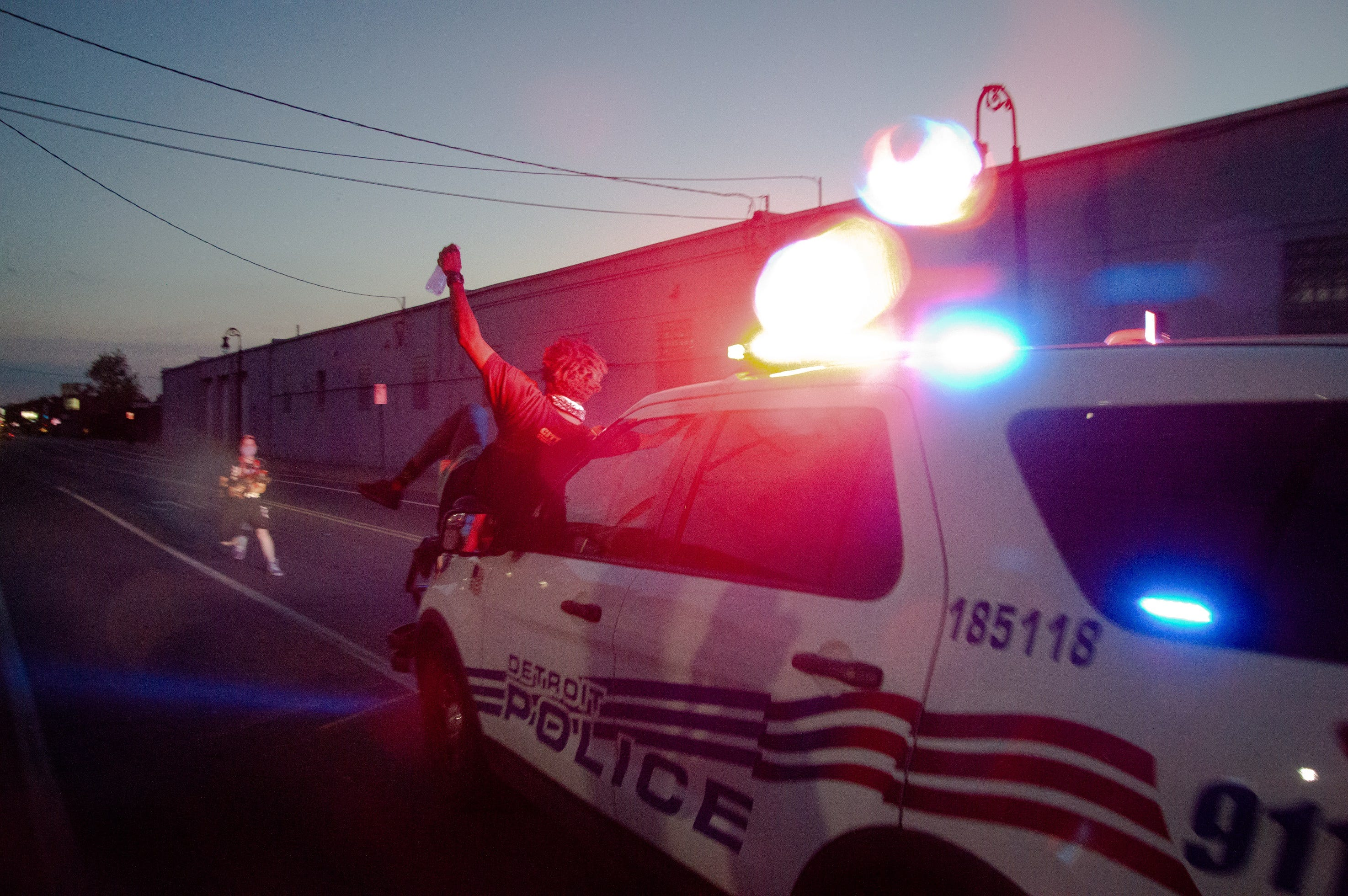 Detroit Police Suv Drives Through Crowd After Protesters Climb On Hood