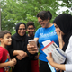 Rashida Tlaib takes a selfie with voters in a scene from the two-part documentary series 'And She Could Be Next.'