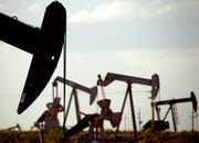 In this April 24, 2015, file photo, pumpjacks work in a field near Lovington, N.M. Then the coronavirus struck again – in a fierce way. Californians, Floridians and Texans are back in hiding, and the recovery in driving that had restored highway travel nationwide back to 85% of last year's levels is looking more fragile than ever.
