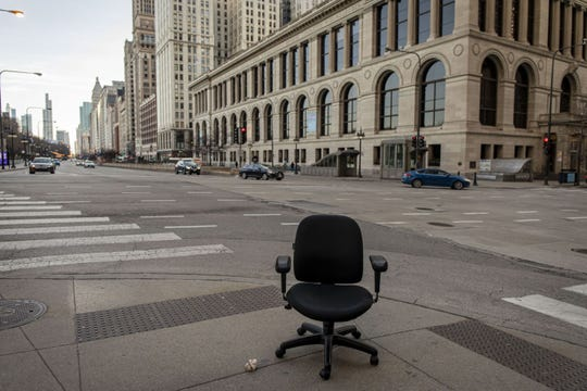 An abandoned desk chair at Michigan Avenue and Randolph Street during the 5 p.m. evening rush hour on March 17, 2020, in Chicago's Loop.