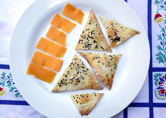 Homemade crispy sesame crackers.