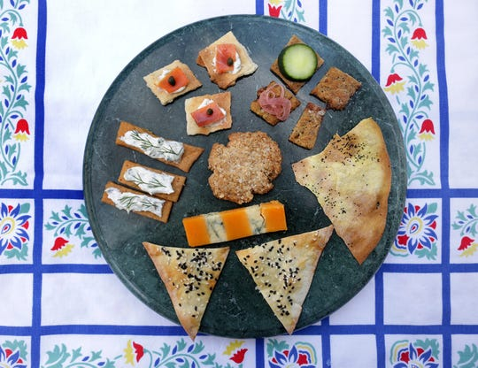 Homemade crackers can be served with an assortment of toppings.