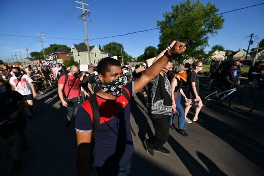 Samuel Paupore of Detroit, marching down Toledo Street in Detroit, Michigan on June 29, 2020.