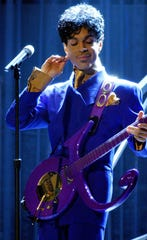 "In a file photo, Prince performs ""Purple Rain"" as the opening act during the 46th Annual Grammy Awards show on Feb. 8, 2004, at Staples Center in Los Angeles."
