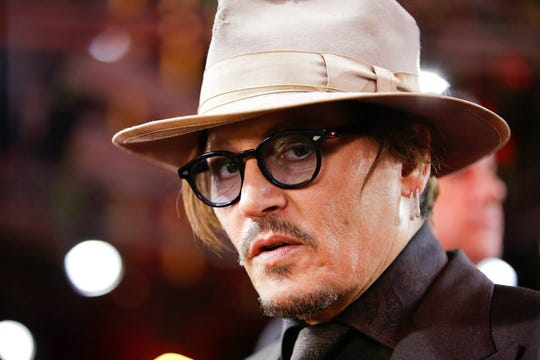 In this Friday, Feb. 21, 2020 file photo, actor Johnny Depp arrives for the screening of the film Minamata in Berlin. Lawyers for British tabloid The Sun asked a judge on Thursday, June 25, 2020 to throw out Johnny Depp's libel claim against the paper because the film star allegedly failed to disclose evidence relating to his drug use.