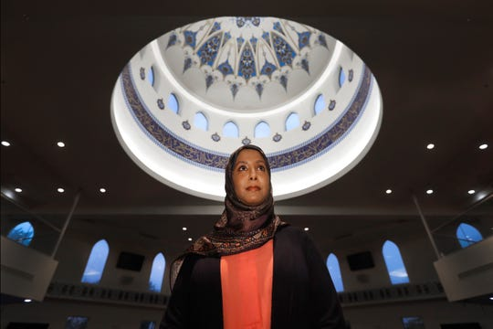 """Hind Makki, seen in Orland Park, Illinois, remembers how, as a young girl, she would hear an Arabic word that means """"slave"""" casually used to refer to Blacks."""