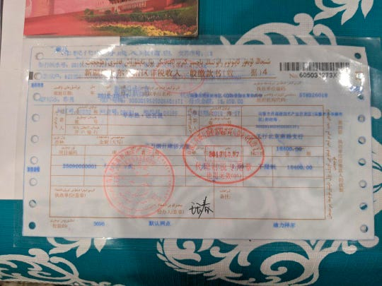 The receipt for a fine levied on Zumret Dawut, a Uighur woman from China's far western Xinjiang region, for having too many children. Dawut, who now lives in Woodbridge, Va., says she was fined 18,400 RMB ($2,600) for having a third child and forcibly sterilized after being released from a Xinjiang detention camp.
