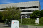 This is an April 30, 2020, file photo showing Gilead Sciences headquarters in Foster City, Calif. The maker of a drug shown to shorten recovery time for severely ill COVID-19 patients says it will charge $2,340 for a typical treatment course for people covered by government health programs in the United States and other developed countries.