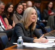 Kathy Kraninger, director of the Consumer Financial Protection Bureau, takes questions from the House Financial Services Committee's biannual review in Washington, Thursday, March 7, 2019.