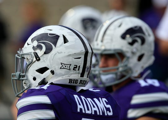 """Kansas State football players say they will boycott all team activities until administrators create a policy that would allow a student to be expelled for """"openly racist, threatening or disrespectful actions."""""""