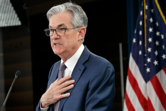 """Federal Reserve Chair Jerome Powell says the outlook for the U.S. economy is """"extraordinarily uncertain"""" and the success of the recovery effort will depend in large part on the country's ability to contain the spread of the coronavirus."""