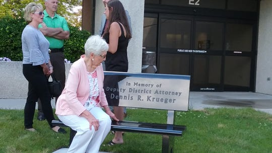 Dennis Krueger's mother, Audrey, takes in her son's memorial bench, dedicated June 24 at the Fond du Lac City County Government building.
