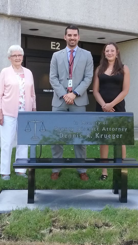 Audrey Krueger, Eric Toney and Crystal Krueger honored Deputy District Attorney Dennis Krueger with a memorial bench June 24 at the Fond du Lac County City County Government building.