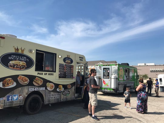 Food trucks gather outside Badger State Brewing Co. on June 28 for its Food Truck Sunday. With so many summer events canceled, local food trucks are finding alternative ways to reach customers.