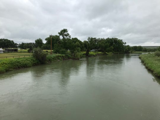 The Sun River was flowing high and wide Monday morning thanks to persistent rainfall.