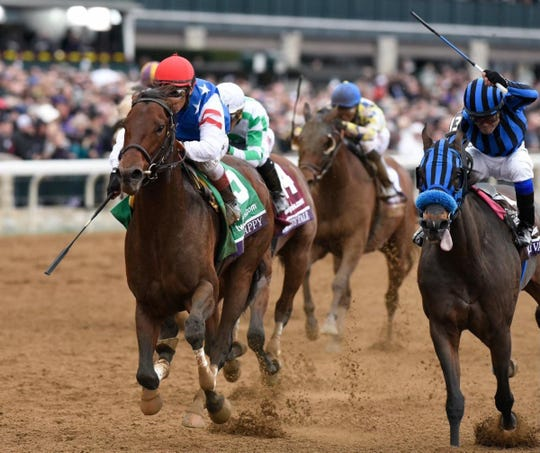 The 3-year-old Runhappy won the $1.5 million Breeders' Cup Sprint under Edgar Prado at Keeneland.
