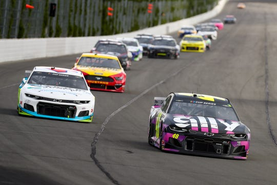 Jun 28, 2020; Long Pond, Pennsylvania, USA; NASCAR Cup Series driver Jimmie Johnson (48) leads driver Bubba Wallace (43) during the Pocono 350 at Pocono Raceway.