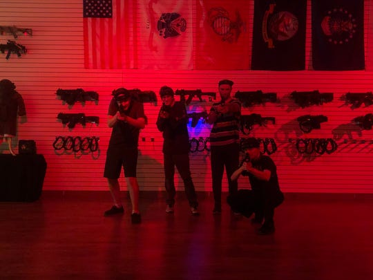 A group of customers at Apex Laser Tag pose for a photos.