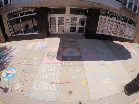 Messages of inclusion shown Monday, June 29, 2020 are written in chalk in front of the Historic Howell Theater.