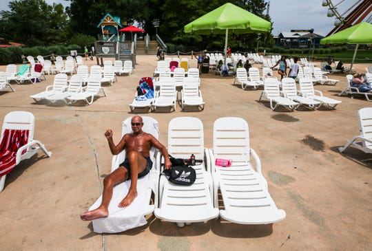 "Relaxing on a beach chair at Hurricane Bay, Bobby Taylor, 67, has been coming to Kentucky Kingdom since the park first opened. He said he was thrilled to be there Monday and wasn't worried about Covid-19. The park has a statement on the Kentucky Kingdom website as well as signage at the park's entrance that recommends people 60 years and older to ""reconsider your visit."" June 29, 2020"