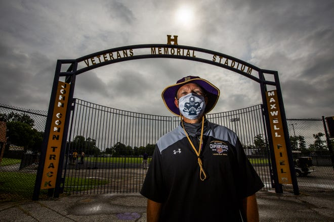 Male High School football coach Chris Wolfe wore a mask while standing at the entrance to Maxwell Field on the first day of conditioning for the 2020 football season. Monday, June 29, 2020.