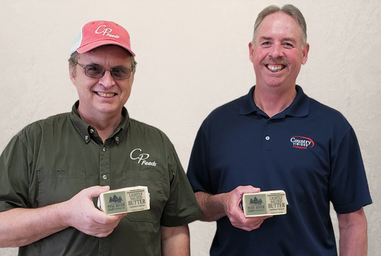 Jim Loefer (left), general manager ofCP Feeds, LLC,and Steve Zutz, CEO of Country Visions Cooperative. The two, along withtheir supply partners, have donated $50,000 worth of dairy products to Feeding America Eastern Wisconsin. 