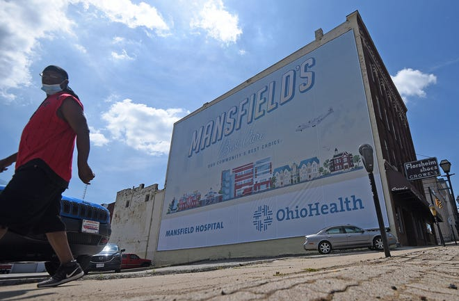 OhioHealth's new wallscape, located in downtown Mansfield's Historic Carrousel District, celebrates the reopening of tourism and local businesses in Mansfield and Richland County.
