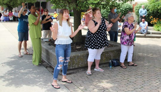 About 70 people from various faith communities in Marion County met Sunday afternoon for a prayer rally outside the Marion County Courthouse in downtown Marion. The sounds of contemporary worship songs and classic hymns echoed throughout the downtown district during the event.
