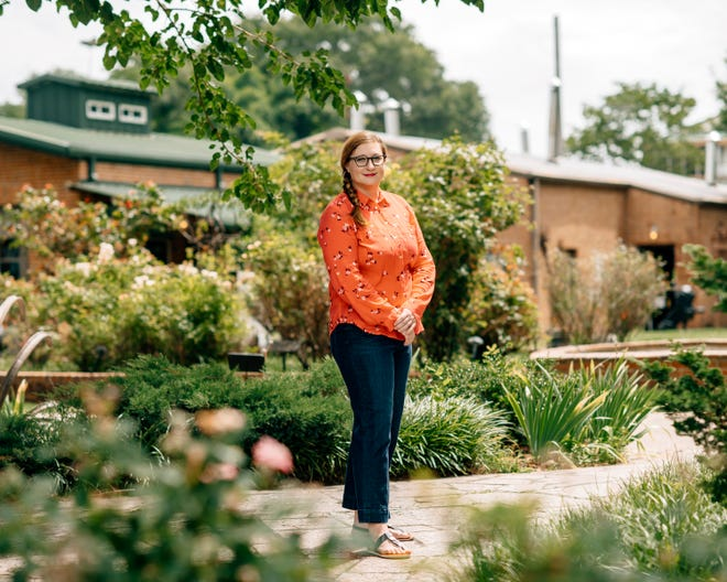 """Holly Whitfield, creator of the """"I Love Memphis"""" blog and author of the new book """"Secret Memphis,"""" poses at the National Ornamental Metal Museum in Memphis on Monday, June 29, 2020. The museum is one of the locations featured in her book."""