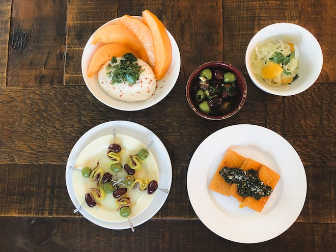 Small plates such as melon with burrata cheese are on the menu at Mina, the newest vendor at Crossroads Collective food hall. It debuts July 1.