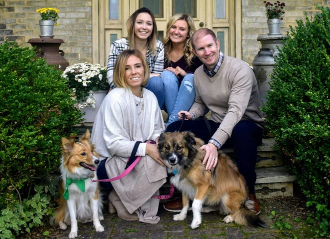 The Misko family of Greenfield will be opening a new dog boarding and dog day care facility at 4305 S. 108th St. in Greenfield. Pictured are (top row, from left) sisters Madison Misko and Mariah Misko and (middle row) Wendy and Chez Misko. Also shown are the family's dogs, Nova (left) and Ahli.