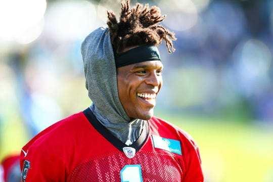 Former Carolina Panthers quarterback Cam Newton (1) smiles during training camp held at Wofford College before the 2019 NFL season.