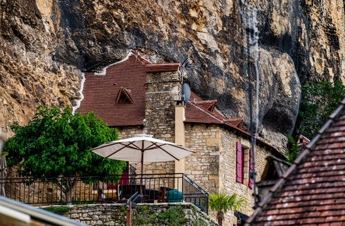 Houses are build into the sheer cliff in La Roque Gageac.