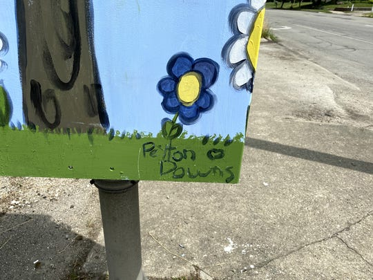 Peyton Downs, a third-grader at St. Lawrence Catholic School, painted her Box! Box! project at the corner of Walnut St. and Memorial Dr.