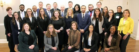 The 2020 Ohio State Bar Association Leadership Academy graduating class  with CEO Mary Amos Augsburger (far left) and 2019-2020 President Eleana Drakatos (far right). The photo was taken pre-COVID-19.