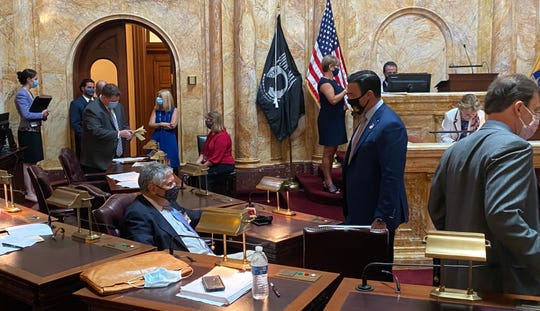Sen. Bob Singer, R-Ocean (left) and Sen. Mike Testa, R-Cumberland, chat during a break in the Senate voting session in Trenton on Monday, June 29, 2020.
